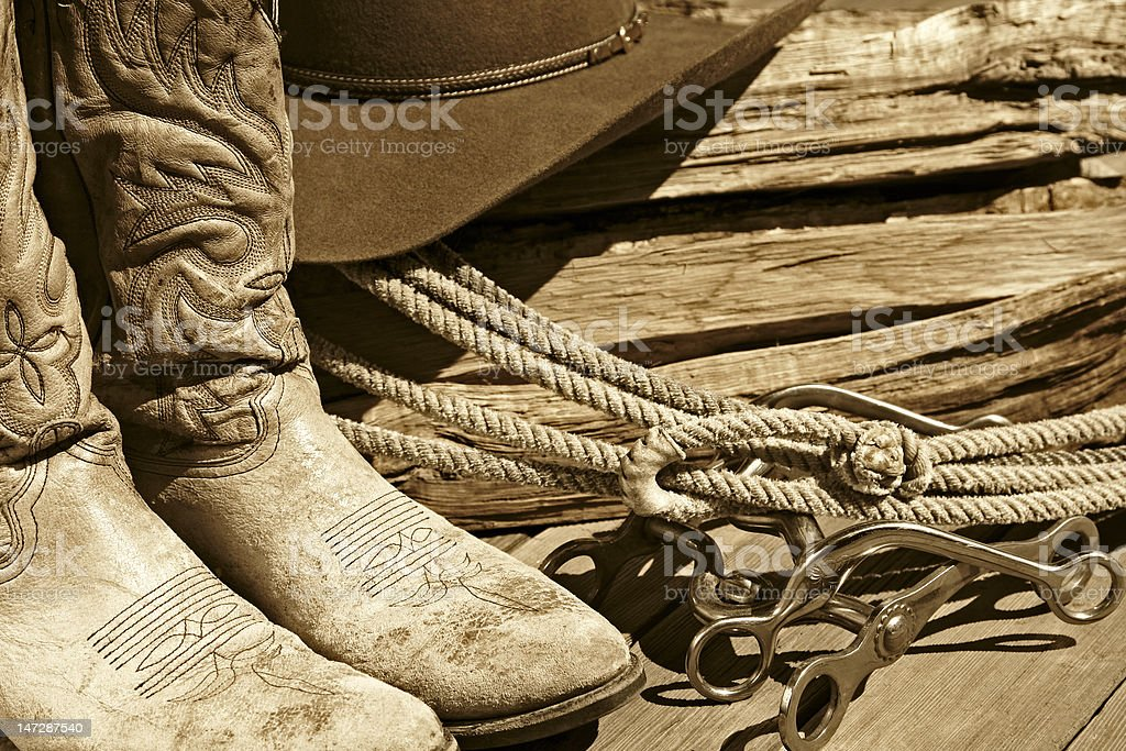 Cowboy Boots, Hat, Rope & Bits (Sepia) royalty-free stock photo