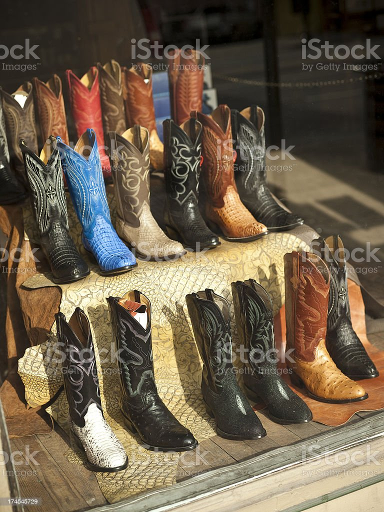 Cowboy boots on shelf for sale royalty-free stock photo