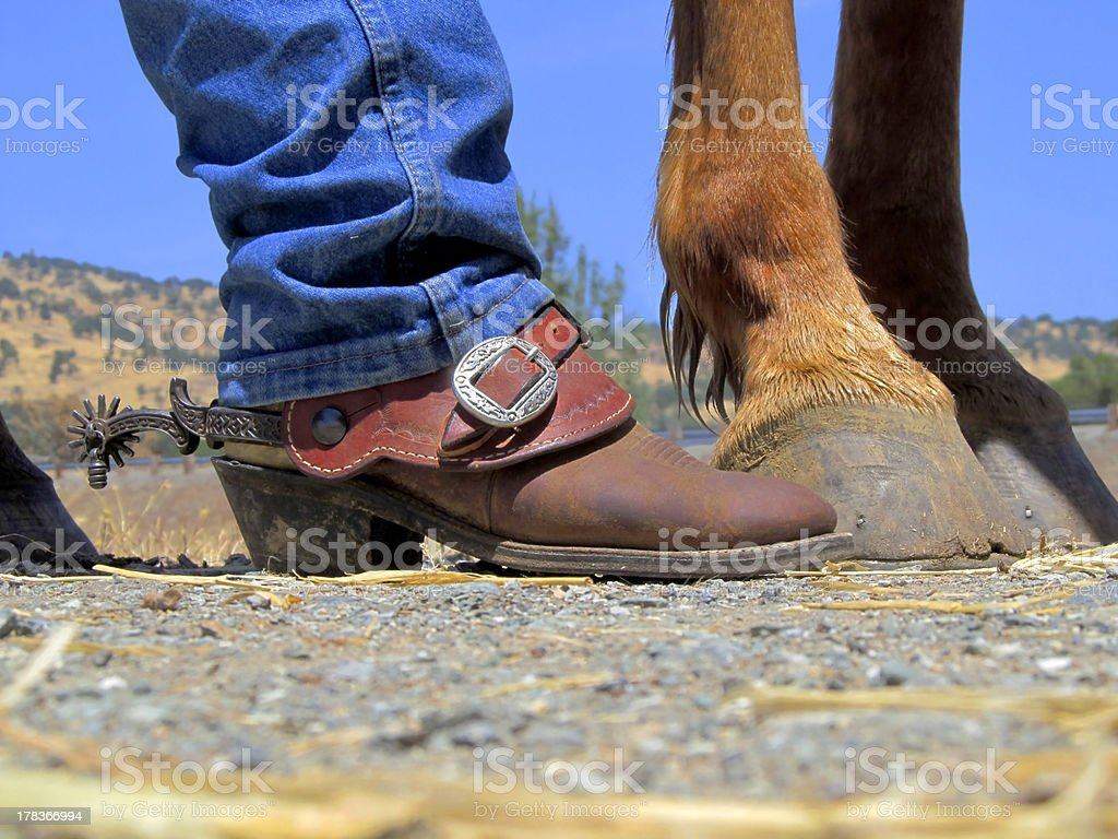 Cowboy Boots, Spurs, Horse's Hooves royalty-free stock photo