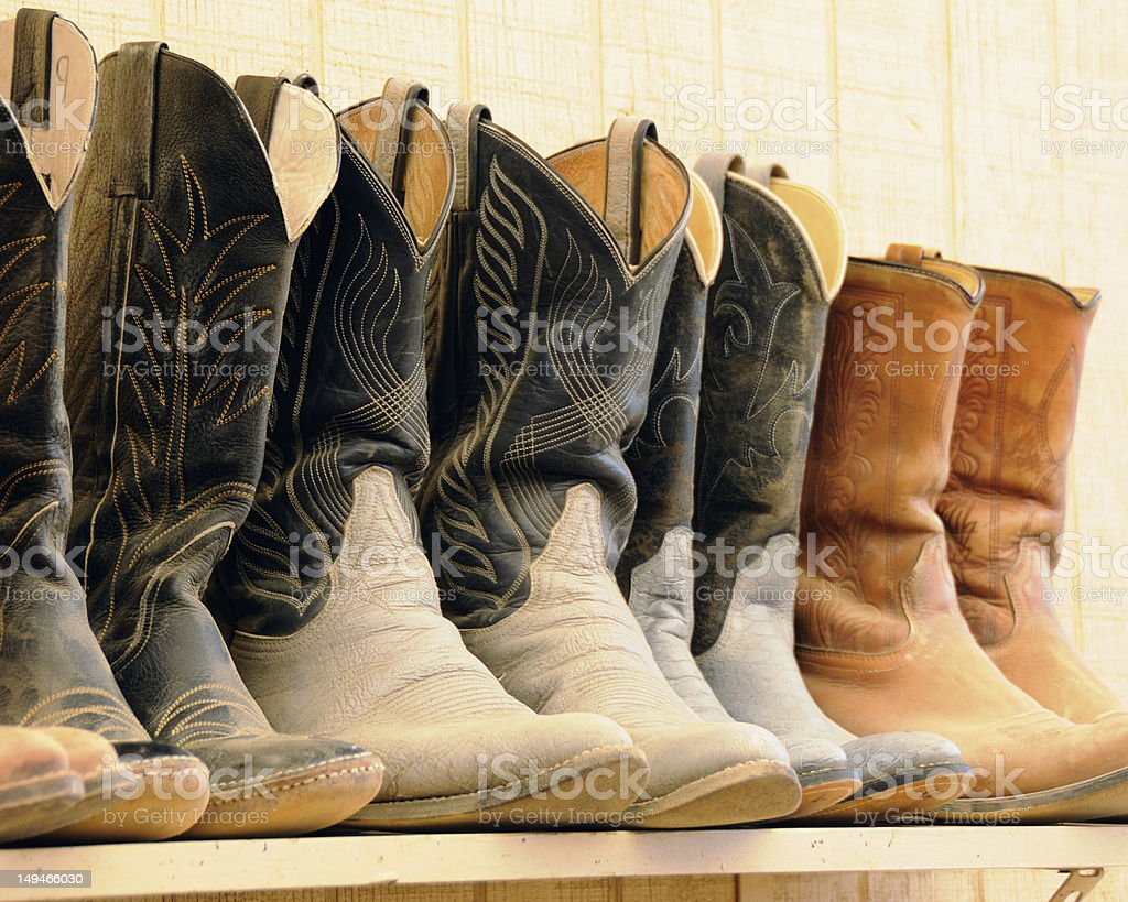 cowboy boots worn on the trail stock photo
