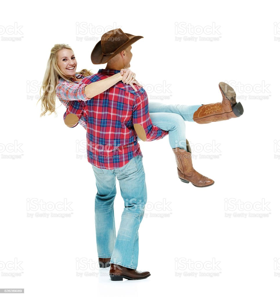 Cowboy couple country dancing stock photo