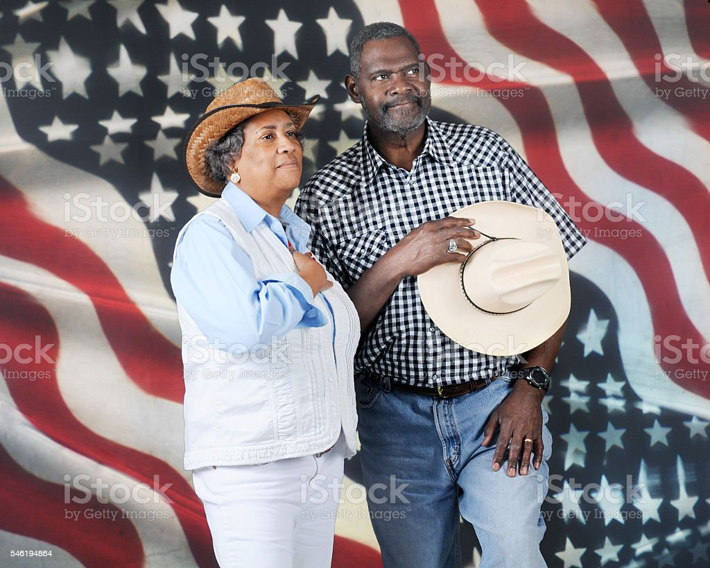 Cowboy Couple Honoring Country stock photo