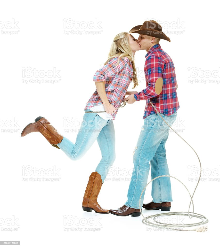 Cowboy couple kissing each other stock photo