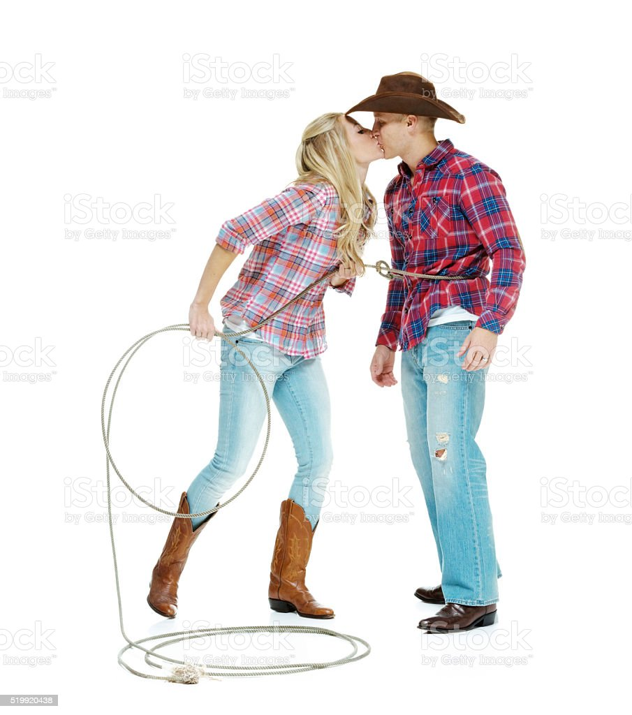 Cowboy couple kissing with each other stock photo