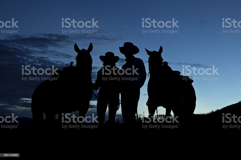 Cowboy Cowgirl and Horses Silhouette royalty-free stock photo