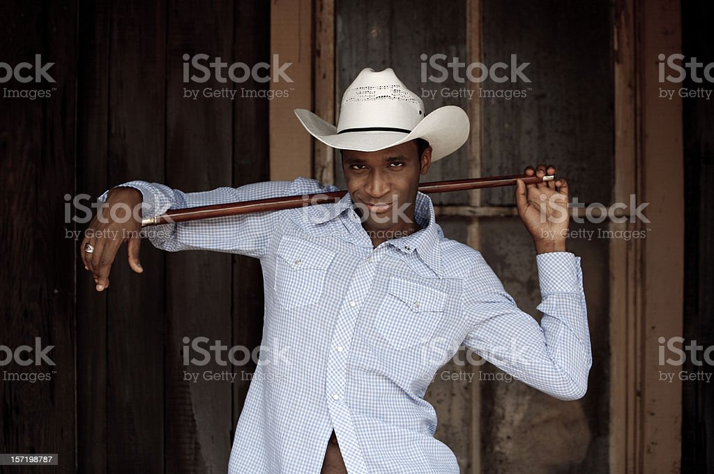 Cowboy dancing with a stick stock photo