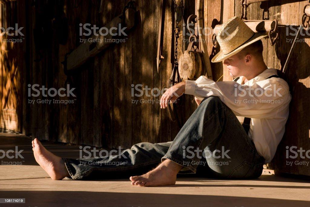 Cowboy Farmer Man Sitting on Deck royalty-free stock photo