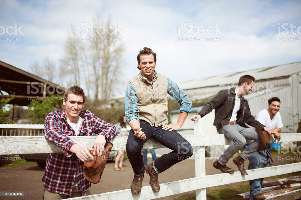Cowboy Friends Hanging Out on Ranch stock photo