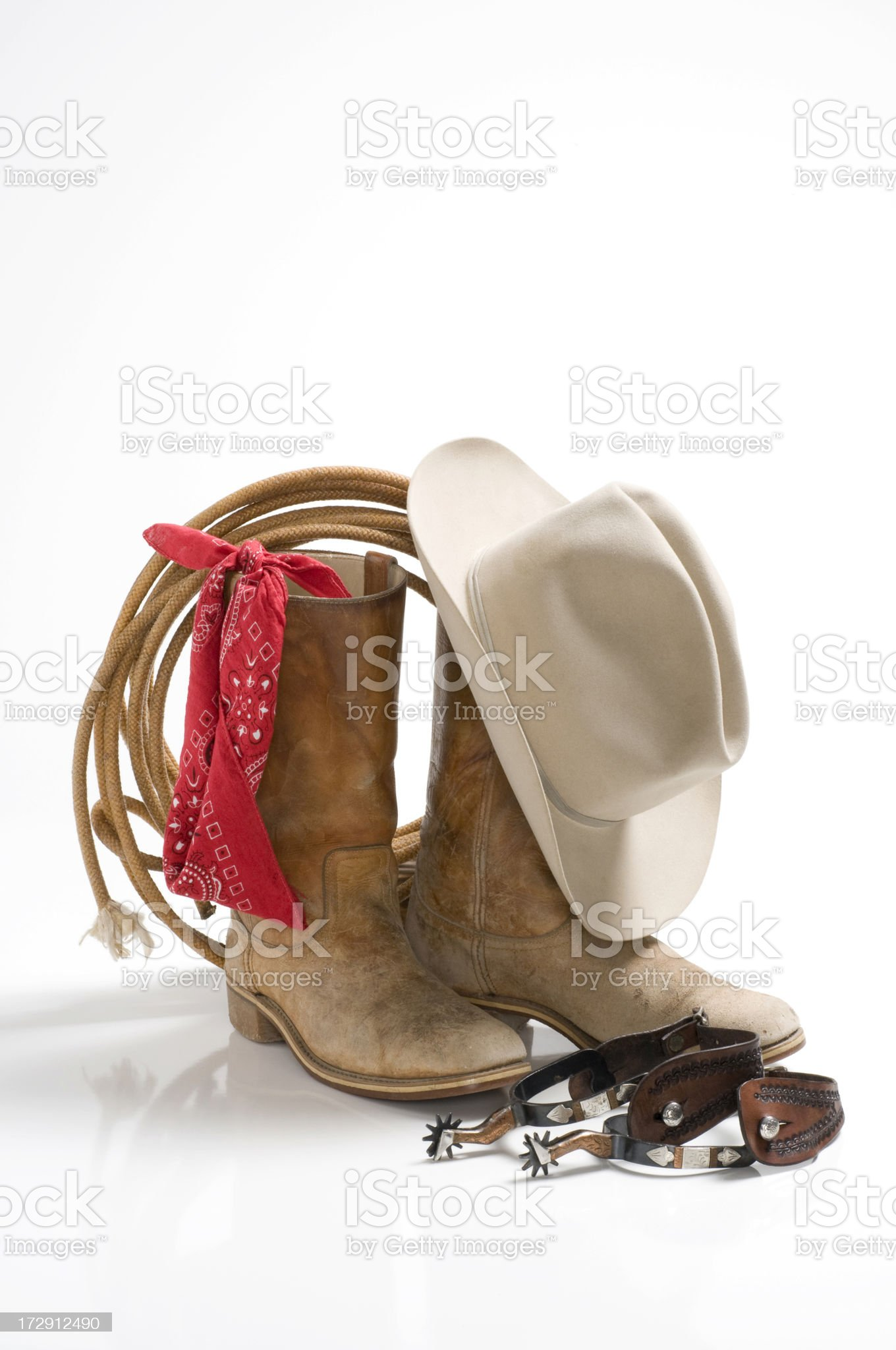 Cowboy gear, hat,boots,spurs,rope,bandana-isolated on white royalty-free stock photo