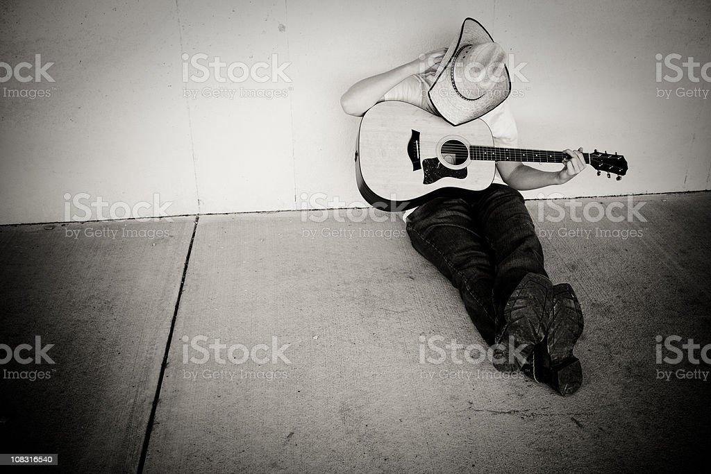 Cowboy & Guitar stock photo