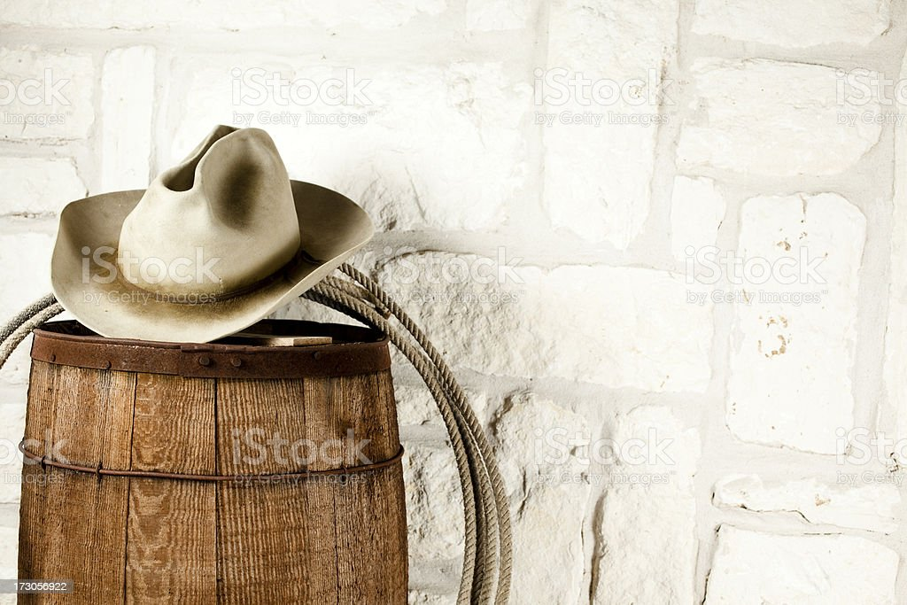 Cowboy hat and lasso on barrel. Austin sandstone background stock photo