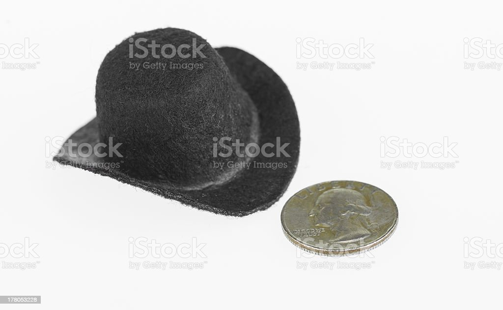 Cowboy hat and old quarter close up royalty-free stock photo