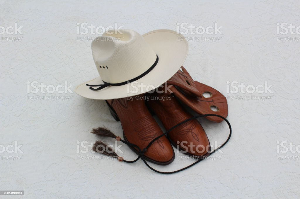 Cowboy Hat Cowboy Boots and Bolo Tie stock photo