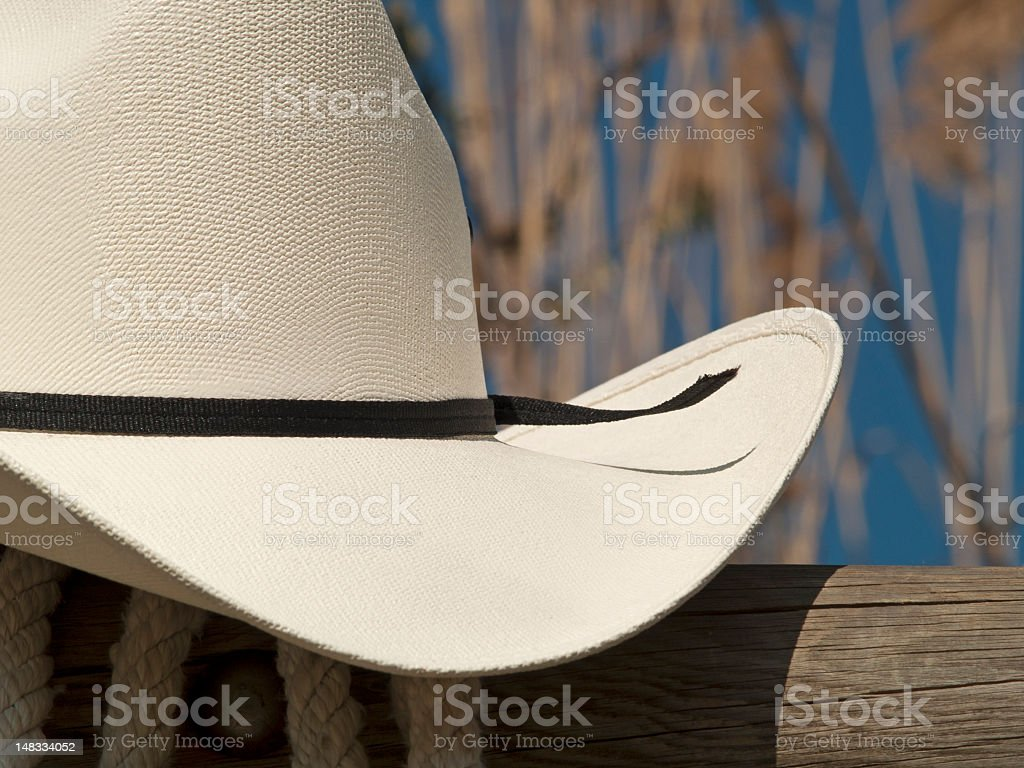 Cowboy hat in a fence close up royalty-free stock photo