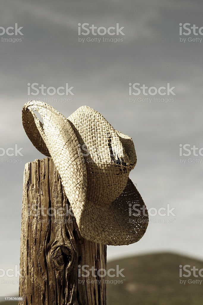 A cowboy hat on the edge of the wood stock photo