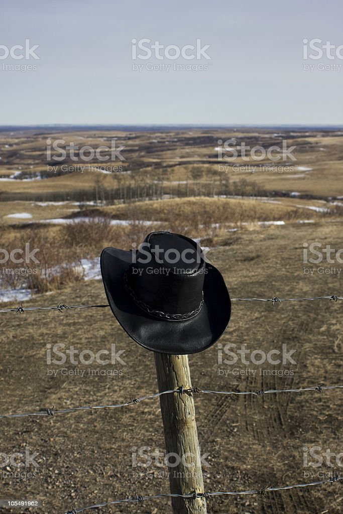 Cowboy hat on the prairie royalty-free stock photo