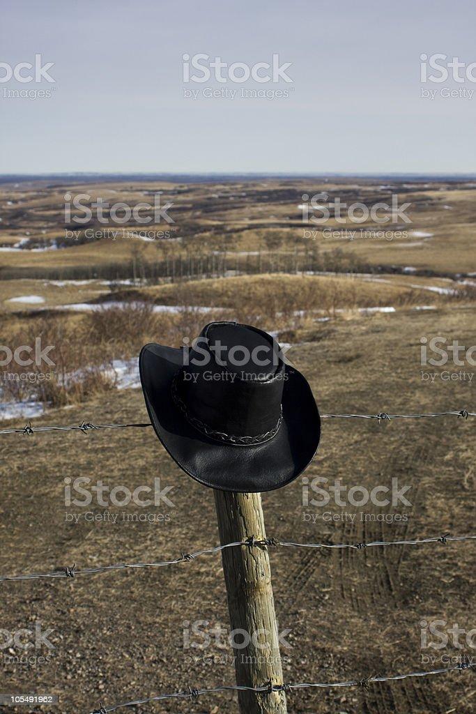 Cowboy hat on the prairie stock photo