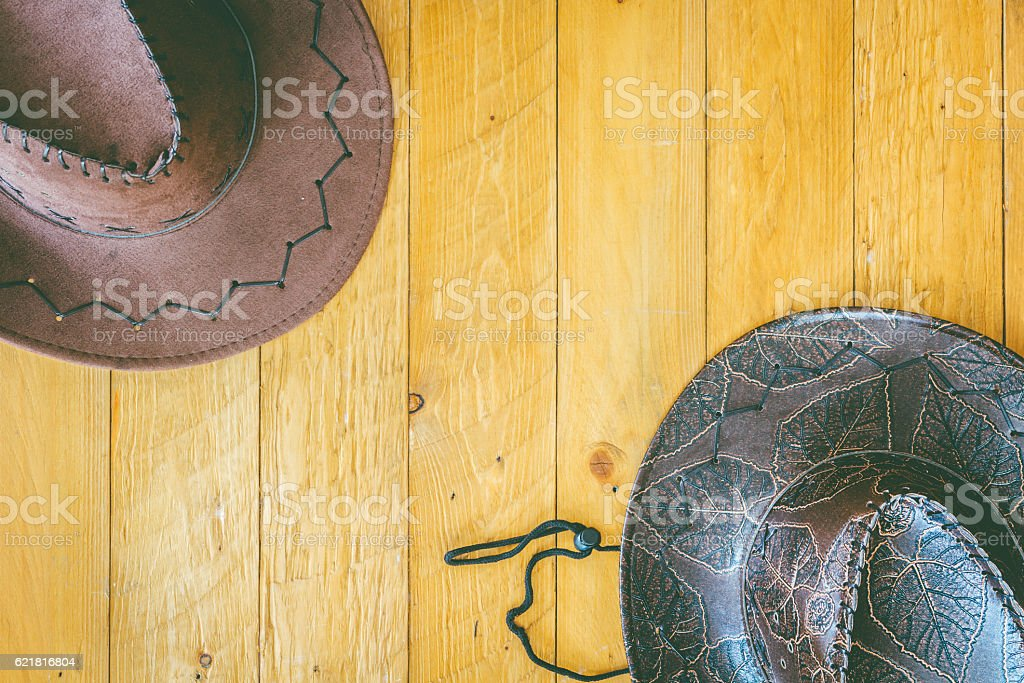 Cowboy hat on wooden background stock photo