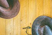 Cowboy hat on wooden background