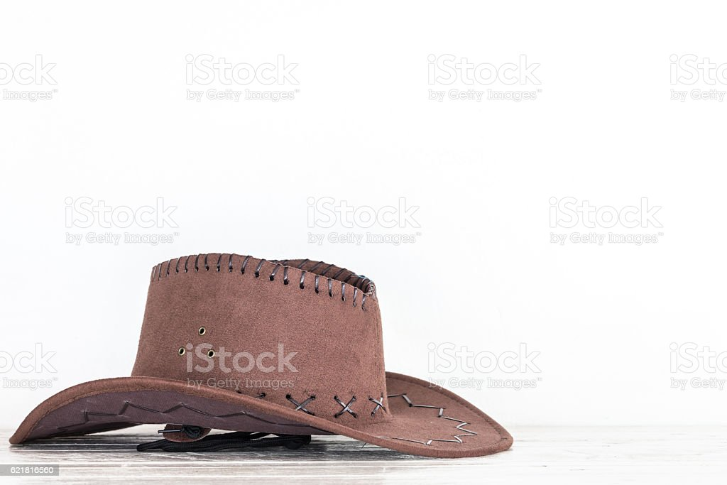 Cowboy hat on wooden table stock photo