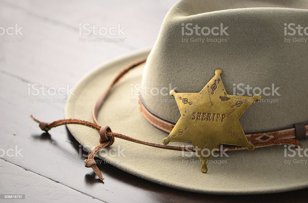 Cowboy hat with Sheriff badge stock photo