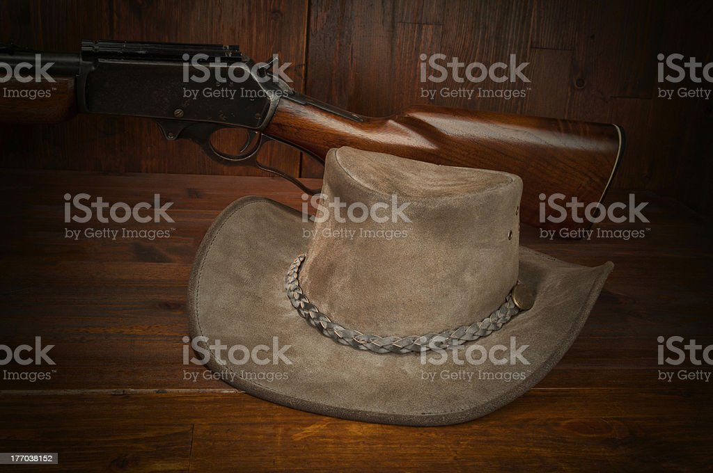 Cowboy hat with Winchester rifle stock photo