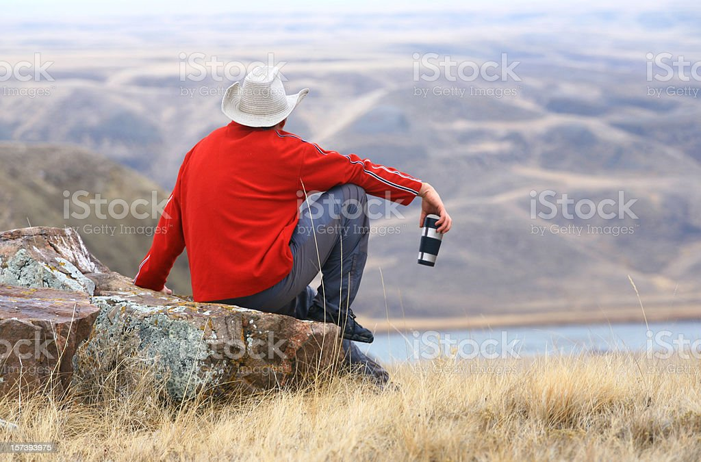 Cowboy Having a Coffee Break on the Ranch in Alberta stock photo