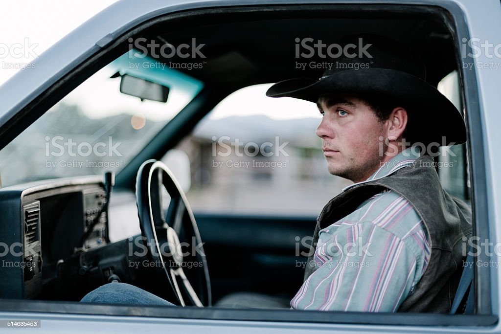 Cowboy in a pick-up truck stock photo