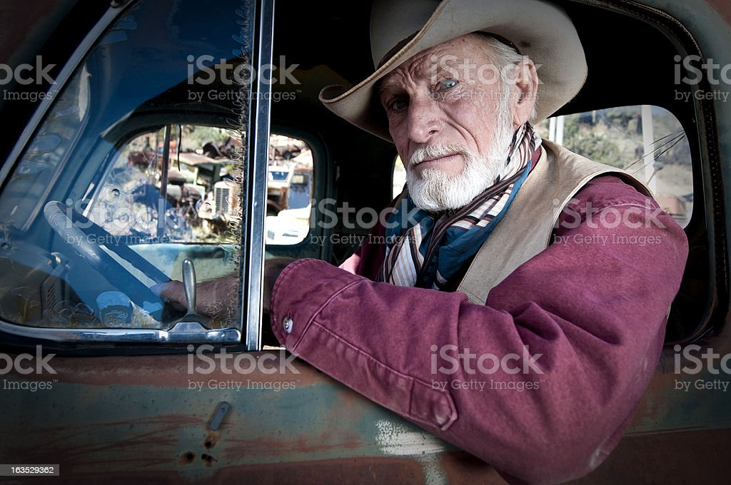 Cowboy in an old truck royalty-free stock photo