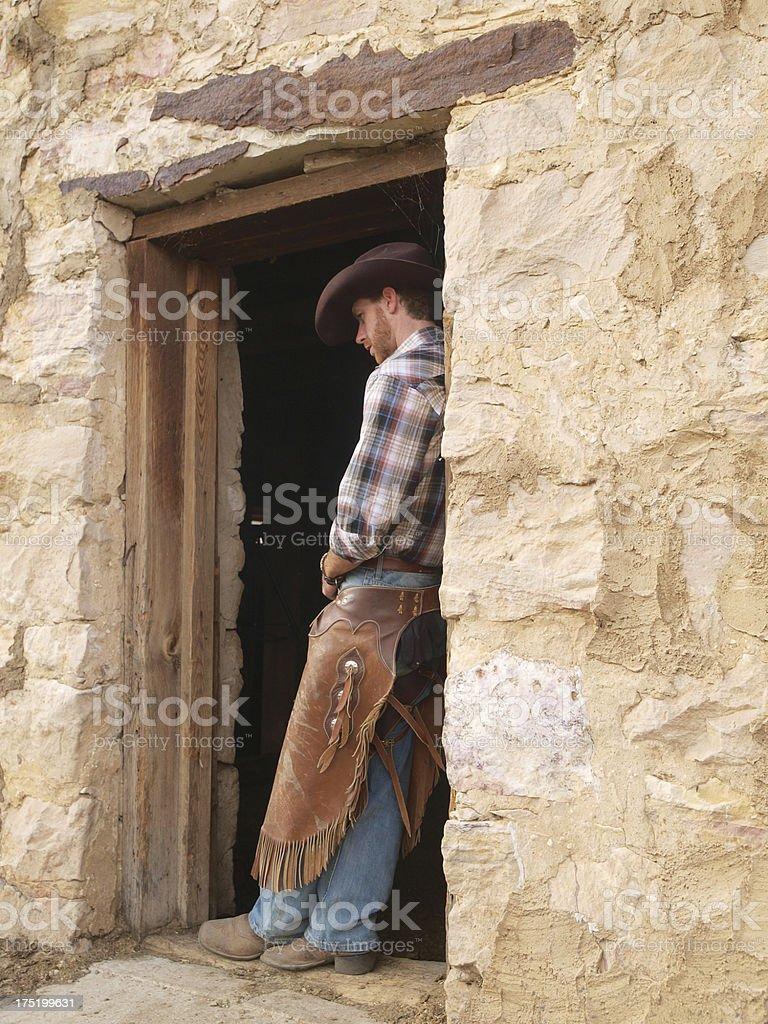 Cowboy in Doorway royalty-free stock photo