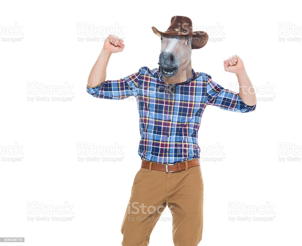 Cowboy in horse costume and cheering stock photo