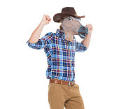 Cowboy in horse costume and cheering
