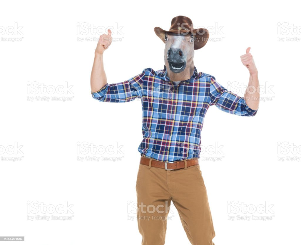 Cowboy in horse costume and giving thumbs up stock photo