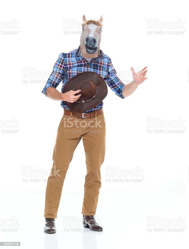 Cowboy in horse costume and waving hand stock photo