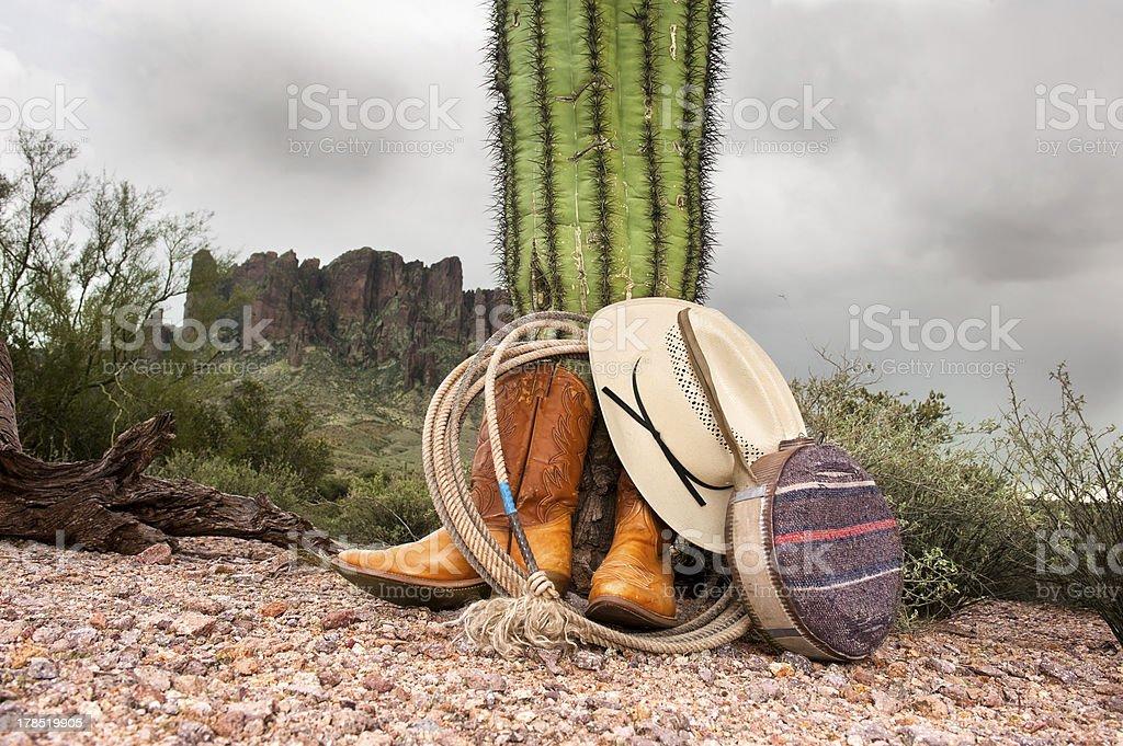 Cowboy items in desert stock photo
