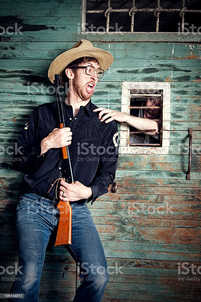 Cowboy Jailer Attacked by Prisoner stock photo