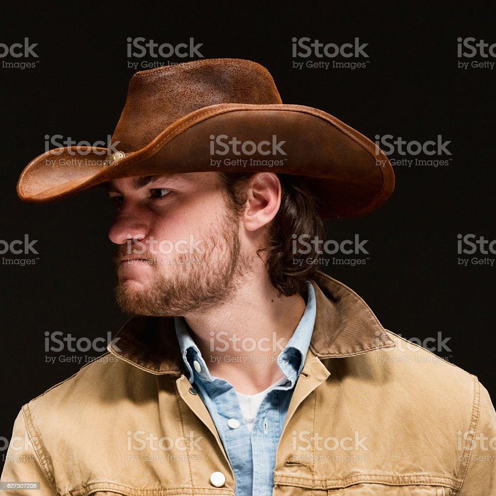 Cowboy looking away stock photo