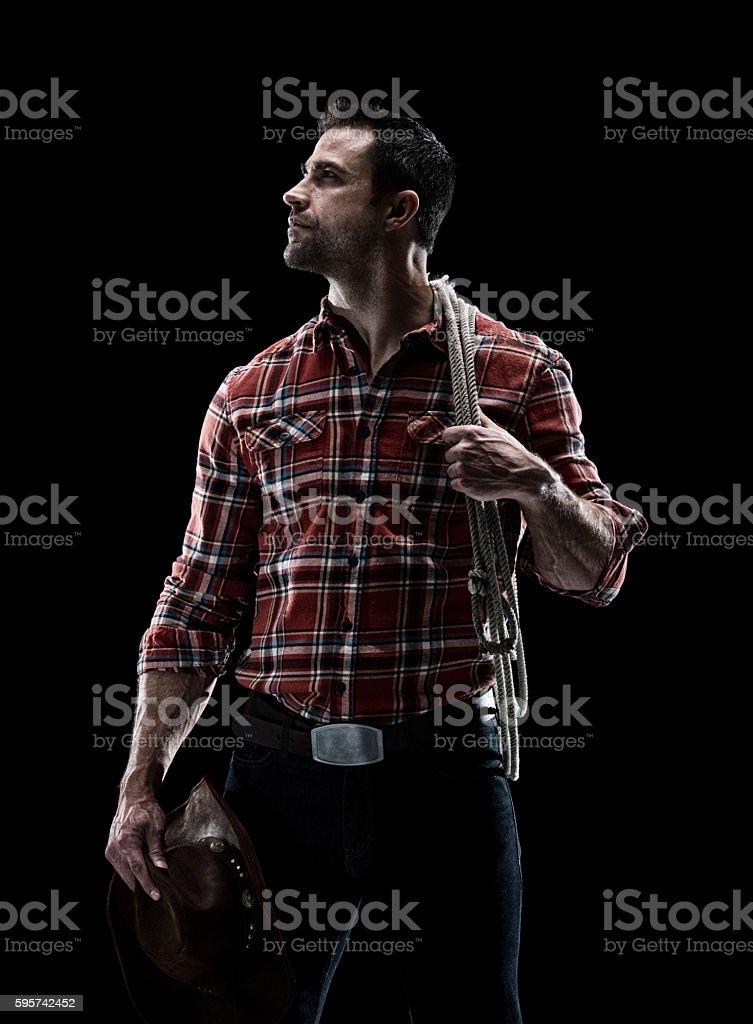 Cowboy looking up stock photo