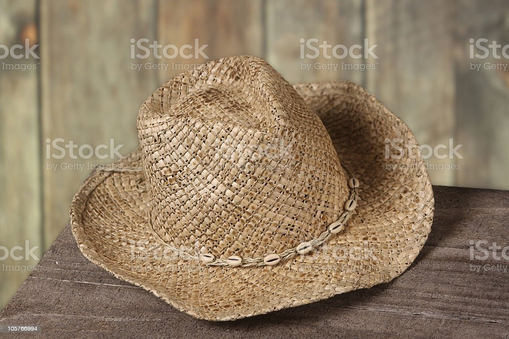 Cowboy or cowgirl hat set against an old wood fence royalty-free stock photo