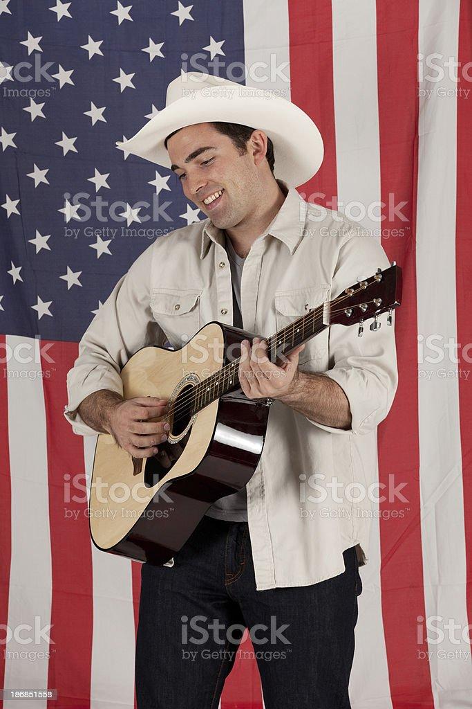 Cowboy playing a guitar royalty-free stock photo