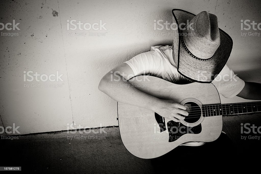 Cowboy playing Guitar stock photo