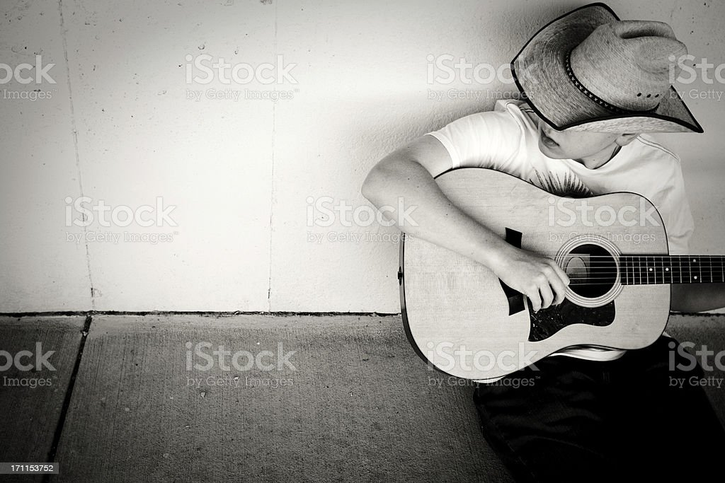 Cowboy Playing Guitar with copy space stock photo