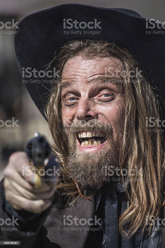 Cowboy Points Gun at You stock photo