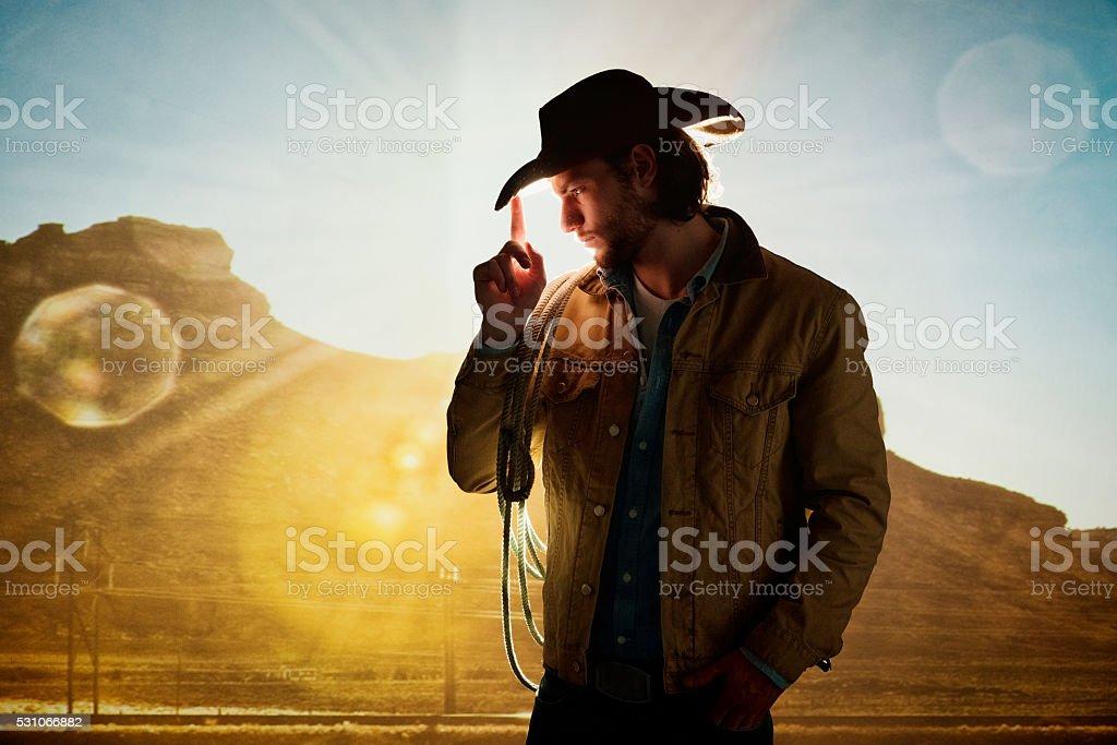 Cowboy posing stock photo