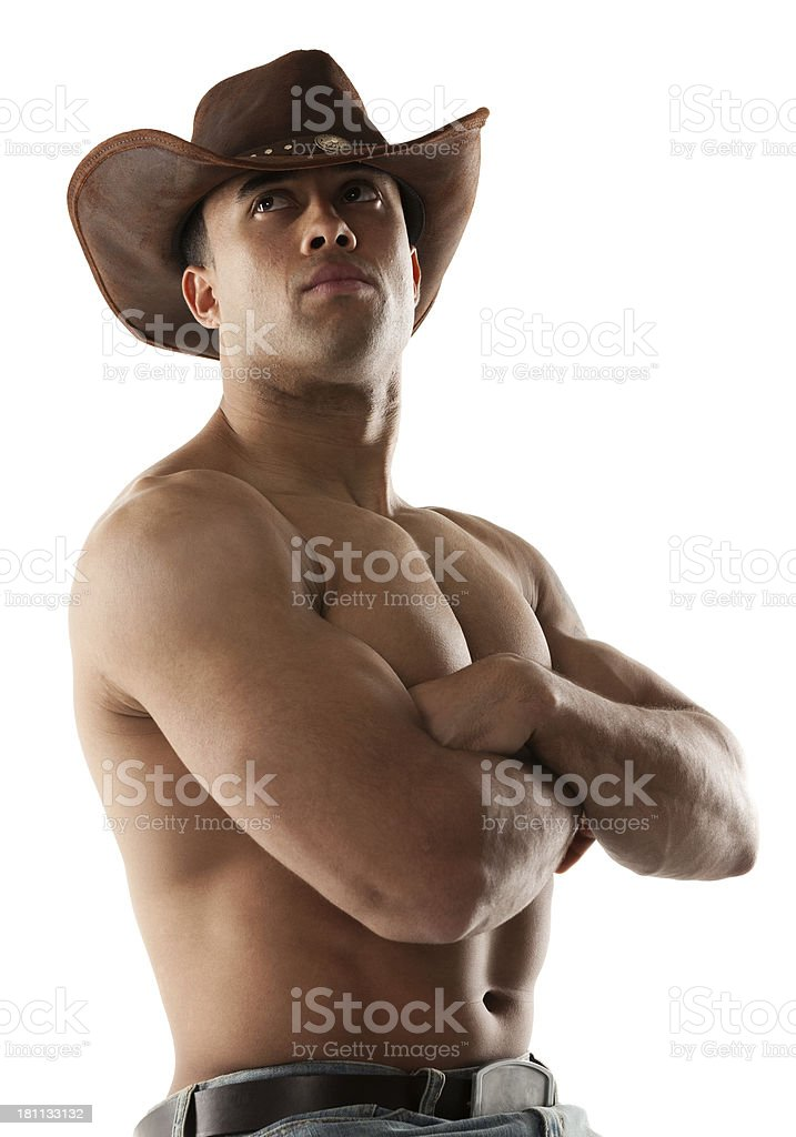 Cowboy posing with arms crossed royalty-free stock photo