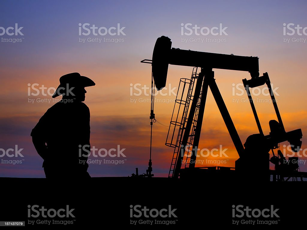 Cowboy Rancher Farmer and Pumpjack royalty-free stock photo