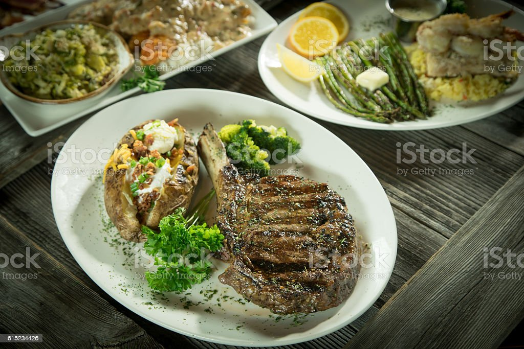 Cowboy ribeye with other plated foods. stock photo