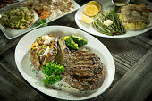 Cowboy ribeye with other plated foods.