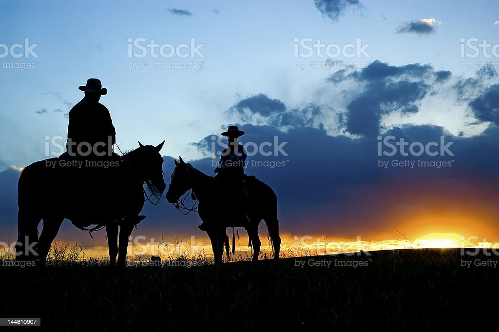 Cowboy silhouette (see others in my portfolio/lghtbox) stock photo