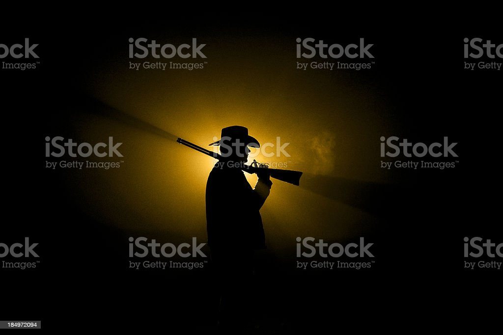 Cowboy Silhouette - Rifle on Shoulder royalty-free stock photo